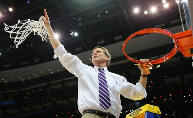 Coach Dave Hixon cuts down the nets.