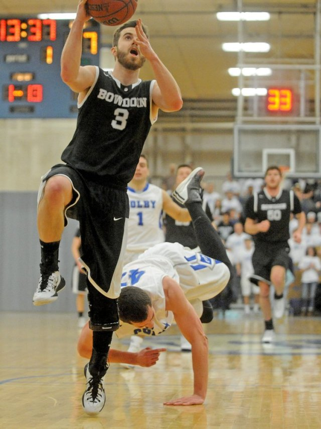 Bryan Hurley '15 goes to the hoop during the Bowdoin comeback against Colby. (Courtesy of the Kennebec Journal)