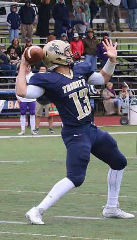 Trinity QB Sonny Puzzo and the Bantams barely escaped from Medford with a win. Robert LeBel/Trinity Athletics)