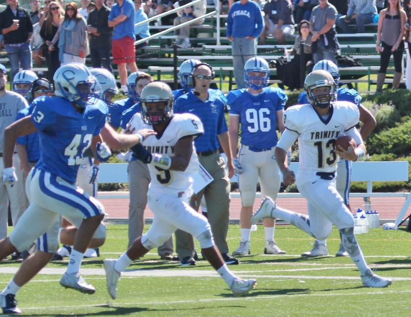 QB Sonny Puzzo '18 (#13) and the Bantams were far too much for Colby to handle last Saturday. (Courtesy of Robert LeBel)