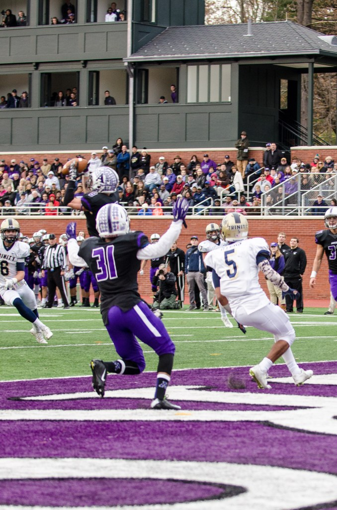 SS Jimmy Fairfield-Sonn '16 hauls in one of his two INTs of the day as Amherst pulled away in the NESCAC Championship race. (Courtesy of Greg Sullivan)