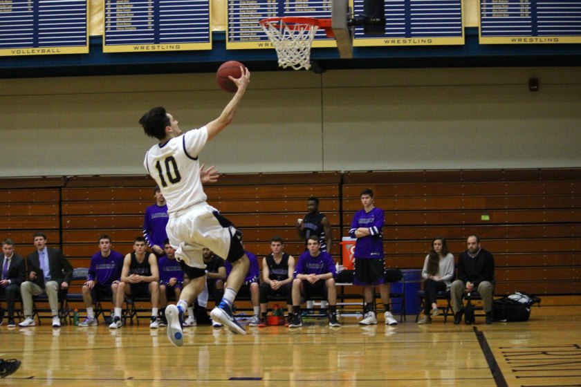Andrew Hurd '16 cruises for an easy two with his luscious hair. (Courtesy of Trinity Athletics)
