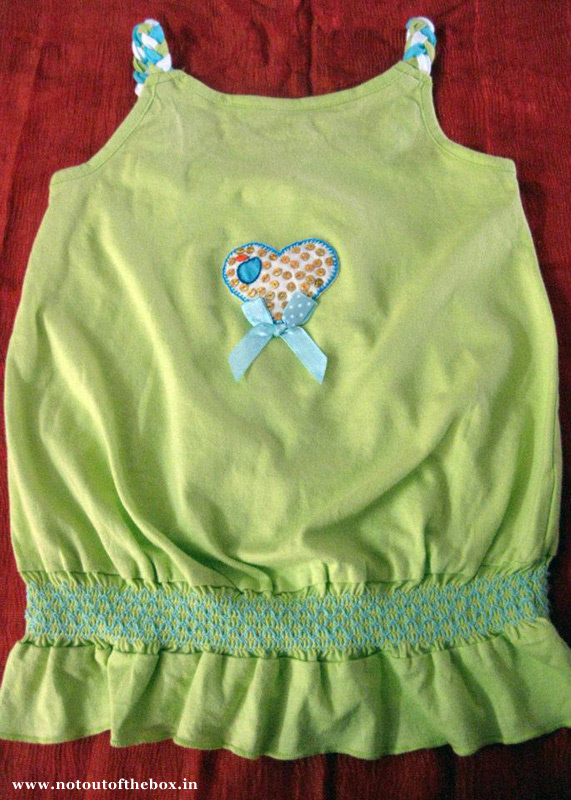 Applique work on baby tunic