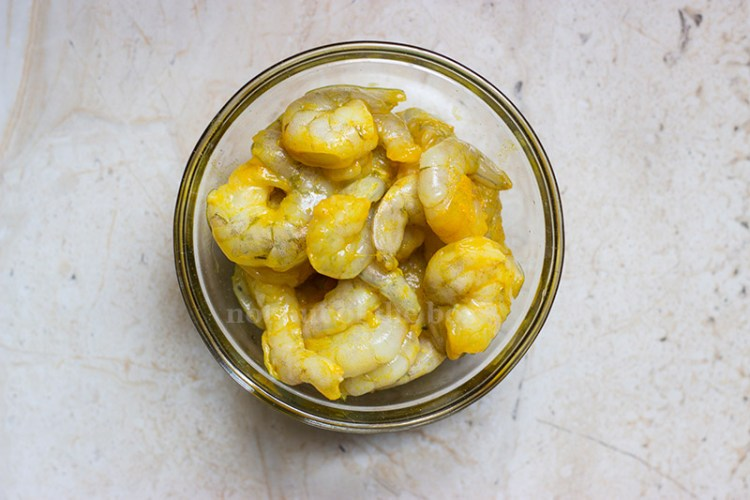 Mix Prawns with salt and turmeric powder