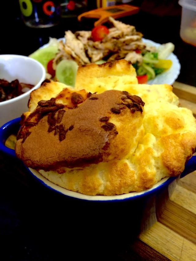 Two Cheese Souffle served with a green salad and caremalised onions
