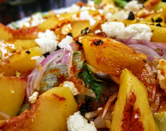 Simple crunchy peach, onion, arugula and feta salad. A perfect accompaniment to grilled meats and cheesy dishes