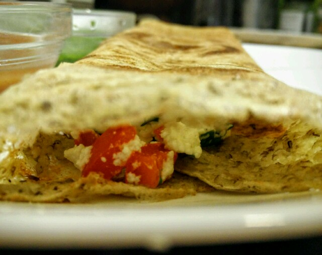 Super nutritious dosa with a cottage cheese and red bell pepper filling