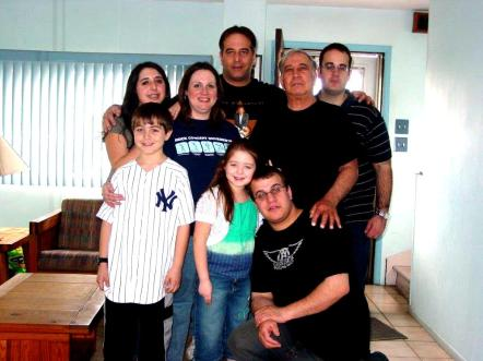 With his three sons, Jimmy Jr.s wife, Susan, and their three children.