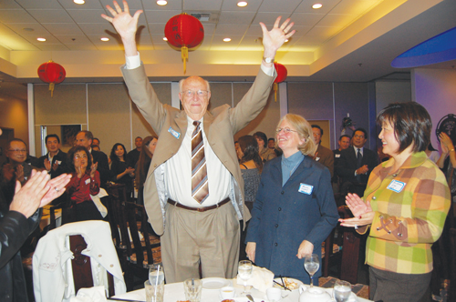 Event attendees give Mimi Gardner Gates and her husband William H. Gates Sr. a standing ovation for their contributions to the arts and Asian communities.