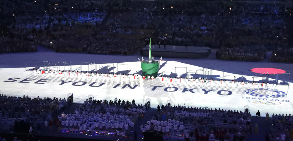 """""""See you in Tokyo"""" is projected on the floor during the closing ceremony in Rio de Janeiro on Aug. 21. (Photo by Chris Carlson/AP)"""