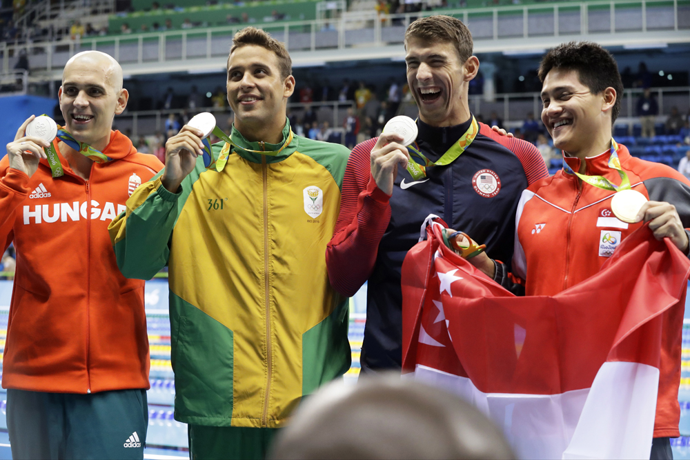 From left: Silver medal winners Hungary's Laszlo Cseh, South Africa's Chad Le Clos and United States' Michael Phelps and Singapore's gold medal winner Joseph Schooling celebrate. (Photo by Dmitri Lovetsky/AP)