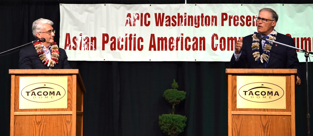 Bill Bryant (L) and Gov. Jay Inslee (R) discuss their views in a forum for the APIC democracy summit. (Photo by Arlene Dennistoun/NWAW)