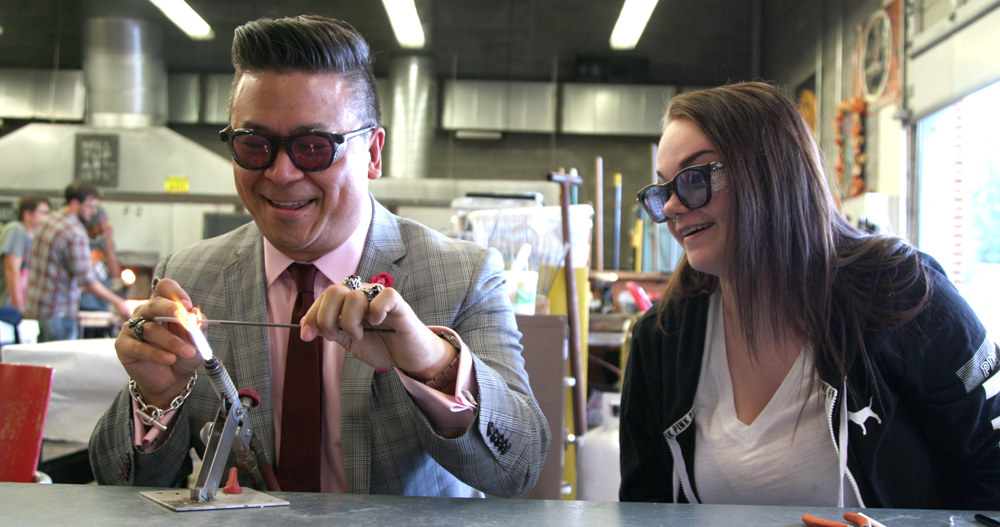 Dr. Christopher Kodama creating glass beads with Taylor Haunhorst, a member of the Hilltop Artists program at Jason Lee Middle School in Tacoma. (Photo by Nathaniel Hansen, Tripod Studios)