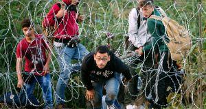 A Syrian refugee runs after
