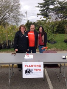 Larry Ferrandiz (center) of PSEG Long Island at last spring's Energy-Saving Trees event
