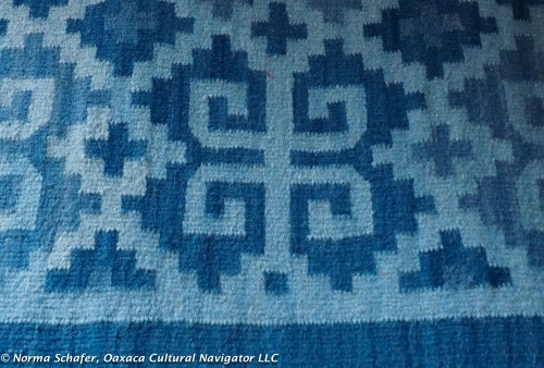 Handwoven indigo rug with dye prepared by Juana.