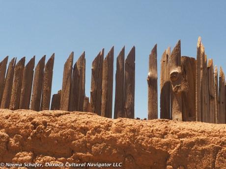 Stockade fence, adobe wall, unresistable texture