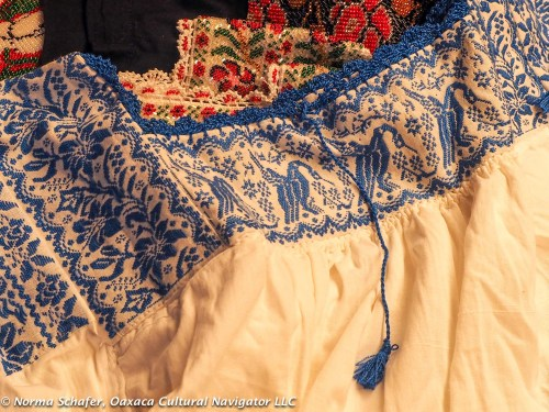 Ducks parade across the embroidered bodice of this blouse made by Radegundis