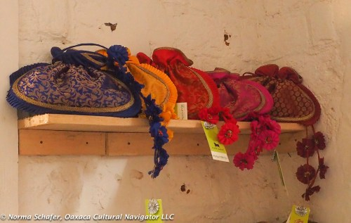 Silk-cotton draw string bags worn with the sari