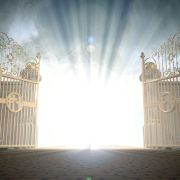 36164768 - a depiction of the pearly gates of heaven open with the bright side of heaven contrasting with the duller foreground