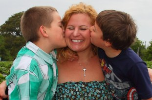 Sue Artz with her sons, Jasper and Ozzie, on Mother's Day 2013 at the the Point Harbor Pick-Your-Own Strawberry Patch. (photo by OBXentertainment.com)