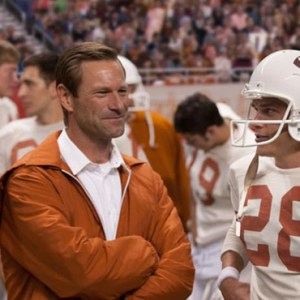 """AARON ECKHART AND FINN WITTROCK STAR IN A SCENE FROM THE MOVIE """"MY ALL AMERICAN."""" THE CATHOLIC NEWS SERVICE CLASSIFICATION IS A-II -- ADULTS AND ADOLESCENTS. HE MOTION PICTURE ASSOCIATION OF AMERICA RATING IS PG-13 -- PARENTS STRONGLY CAUTIONED. SOME MATERIAL MAY BE INAPPROPRIATE FOR CHILDREN UNDER 13. (CNS PHOTO/CLARIUS ENTERTAINMENT)"""