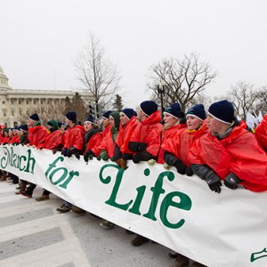 YOUNG PEOPLE WALK WITH A BANNER PAST THE U.S. CAPITOL IN 2012 DURING THE ANNUAL MARCH FOR LIFE IN WASHINGTON. (CNS PHOTO/BOB ROLLER)