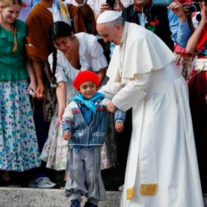 POPE FRANCIS POSITIONS A BOY FOR A PHOTO AS HE MEETS AN ARGENTINE GROUP DURING HIS GENERAL AUDIENCE IN ST. PETER'S SQUARE AT THE VATICAN OCT. 19. / PHOTO: (CNS PHOTO/PAUL HARING)