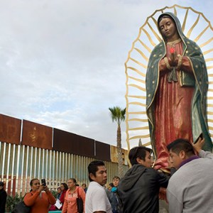 A STATUE OF OUR LADY OF GUADALUPE IS UNLOADED FROM A TRUCK AFTER A NOV. 19 PROCESSION TO THE U.S.-MEXICO BORDER FENCE IN TIJUANA, MEXICO, WHERE MASS WAS CELEBRATED. THE MASS AND A PROCESSION WITH A STATUE OF OUR LADY OF GUADALUPE WERE A CALL TO REMEMBER AND PRAY FOR MIGRANTS AND WERE LED BY ARCHBISHOP FRANCISCO MORENO BARRON OF TIJUANA./ PHOTO:  (CNS PHOTO/DAVID MAUNG)