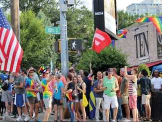 Orlando supporters rally at the intersection of 10th and Piedmont where many gathered one year ago to celebrate the U.S. Supreme Court's decision on marriage equality. Image Source: The GA Voice
