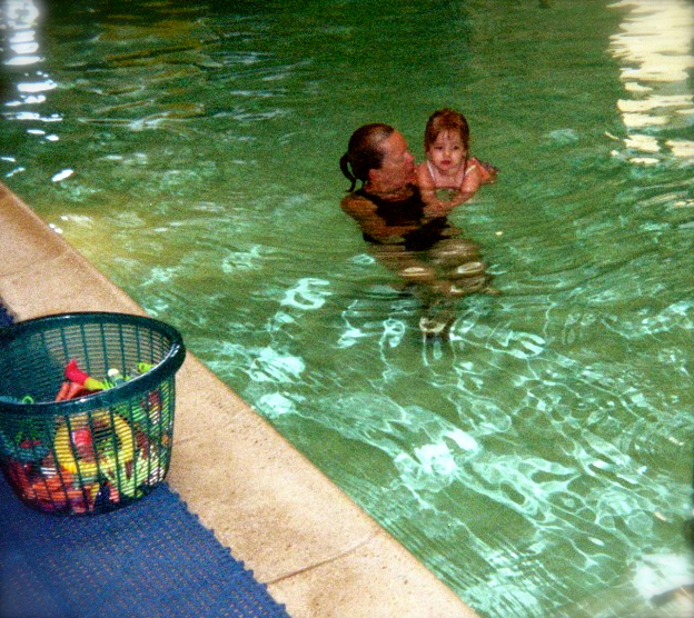 My first daughter at 18 months in her first swim lesson. She's now an avid, proficient swimmer!