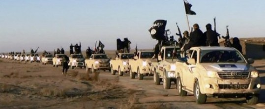 This image posted on a militant website on Tuesday, Jan. 7, 2014, which is consistent with AP reporting, shows a convoy of vehicles and fighters from the al-Qaida-linked Islamic State of Iraq and the Levant (ISIL) fighters in Iraq's Anbar Province.