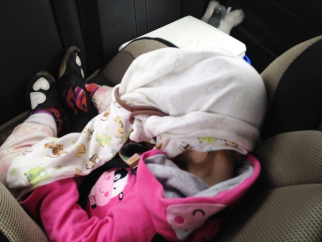 Our daughter sleeping in her carseat on our Maui family vacation.