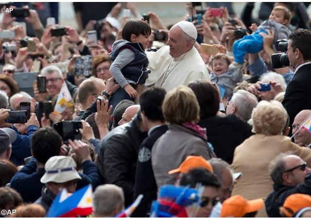 Pope Francis arrives for his weekly General Audience in St. Peter's Square 27 April 2016