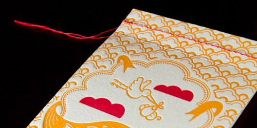 red orange letterpress baby shower invitations stitching 500x250 Katies Red + Orange Baby Shower Invitations