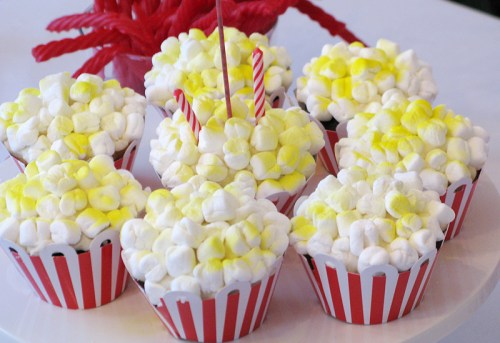 red white blue circus birthday party popcorn cupcakes 500x343 Red + Aqua Carnival Birthday Party Invitations for Grace!