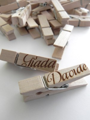 Kraft Paper Lace Wedding Invitations Place Card Clothespins 300x400 Giada + Davides Kraft Paper and Lace Wedding Invitations