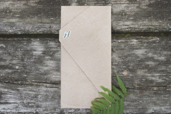 Wrapped Kraft Mint Green Invitations Belinda Love Lee 550x366 Laura + Jeremys Kraft Paper and Mint Green Wedding Invitations