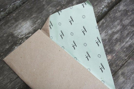 Wrapped Kraft Mint Green Invitations Belinda Love Lee2 550x366 Laura + Jeremys Kraft Paper and Mint Green Wedding Invitations