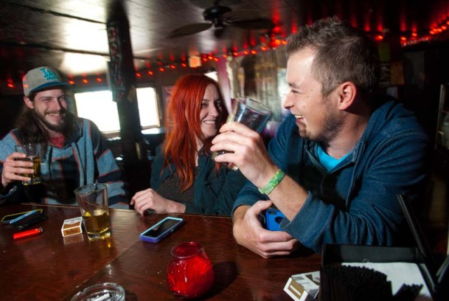 From left, Brandon Porter, Zak Corbett and Dustin Graeber, enjoy the afternoon drinking at Drunken Fry recently. (Mark Hancock)
