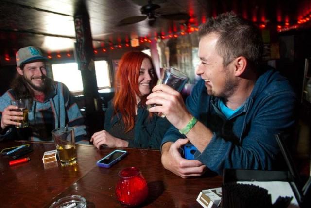 From left, Brandon Porter, Zak Corbett and Dustin Graeber, enjoy the afternoon drinking at Drunken Fry recently. (Mark Hancock)
