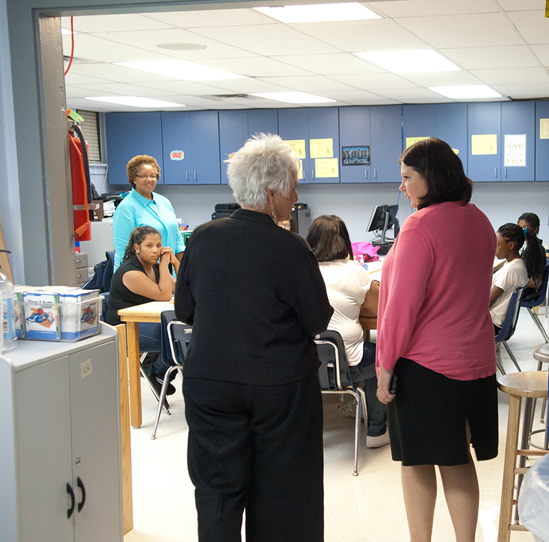 Aurora Lora, right, with Emerson Alternative School's principal, Sherry Kishore, visits Sandra Gooden's Family Consumer Science classroom. (Mark Hancock)