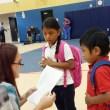 A Mark Twain Elementary teacher helps new students find their class. (Ben Felder)