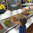 A student at Spencer Elementary selects his lunch. (Mark Hancock)