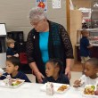 Principal Mary Coughlin with pre-K students in the lunchroom at Spencer Elementary as they have their first Free Lunch. (Mark Hancock)