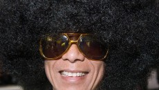 Employee Hoang Nguyen rocks the afro and a big smile at Masquerade (Mark Hancock)