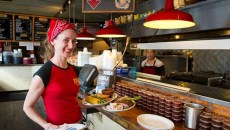 Bonnie F. Montgomery delivers BBQ to customers at Earl's on Western. (Shannon Cornman)