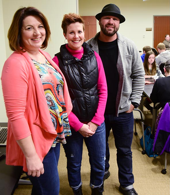 From left, Jane Wilson and Sarah and Steve McLean share stories during an annual family potluck and support gathering for cancer survivors at Integris Cancer Institute. (Mark Hancock)