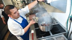 New head chef, Mitchell Dunzy, is busy preparing steamed mussels in the kitchen at Saints.  (Mark Hancock)
