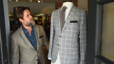 Spencer Stone is wearing a deconstructed blazer made of silk and wool by Isaia, next to a linen sport coat by Di Maestro, at Spencer Stone Company in Nichols Hills Plaza.  mh